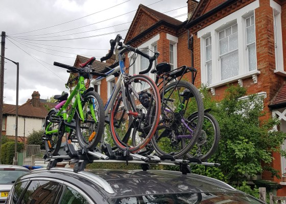 Four bikes on top of a car