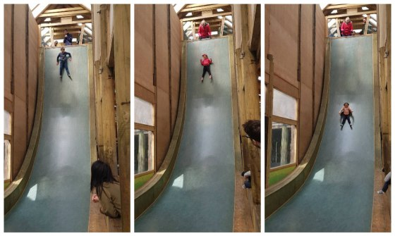 The children sliding down the drop slide